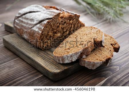 Sliced rye bread on cutting board closeup #456046198