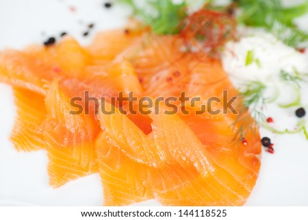 sliced salmon on white dish at fish restaurant