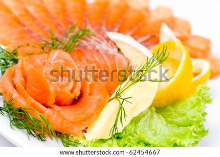 sliced smoked salmon served with lemon and salmon rose