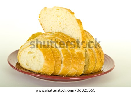 Sliced sourdough bread on brown plate; isolated