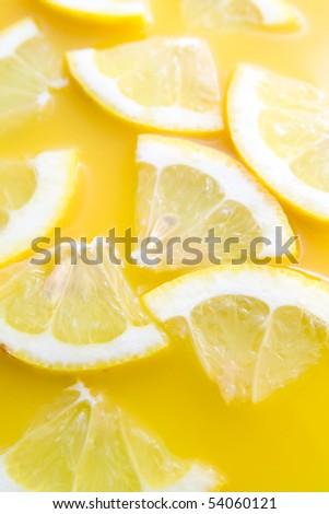 Sliced tasty lemons representing healthy lemon juice - lemonade. #54060121
