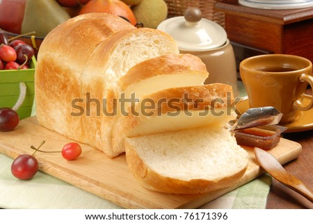 Sliced Toast Breadon  on a Cutting Board - stock photo