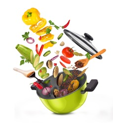 Sliced vegetables on a board, falling into a pan.