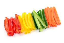 Sliced vegetables, paprika and cucumber on white background, isolated.