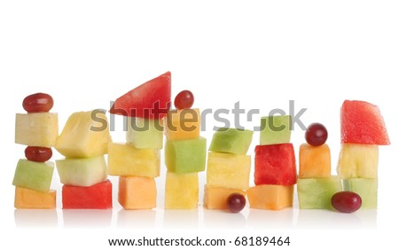 Sliced watermelon, honeydew, pineapple, cantaloupe and grapes isolated on white.