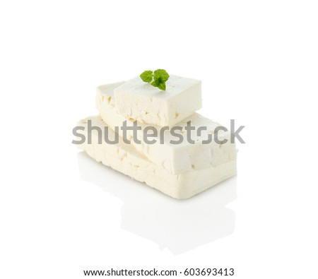 sliced white goat cheese on plate on white background