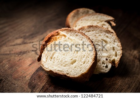 sliced wholemeal sesame bread on brown wood