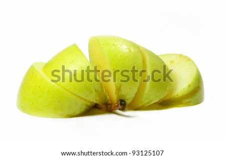 sliced yellow apple isolated on white