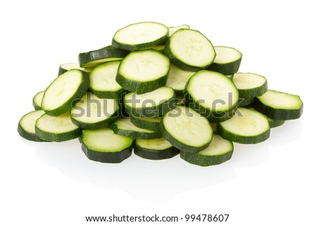 Sliced zucchini pile isolated on white, clipping path included