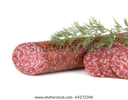 Slices italian salami sausage with dill. Isolated on white background