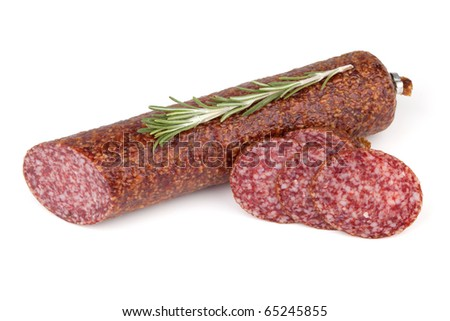 Slices italian salami sausage with rosemary. Isolated on white background