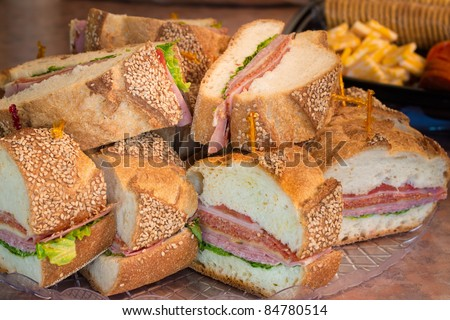 Slices of an Italian party sandwich on a platter