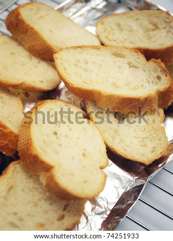 Slices of baguette to be put to oven for reheating