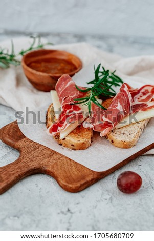 Slices of bread with spanish serrano ham served as tapas Stock photo ©