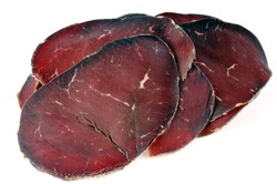 Slices of bresaola in closeup on white background