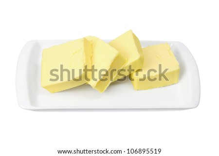 Slices of Butter on Plate on White Background - stock photo