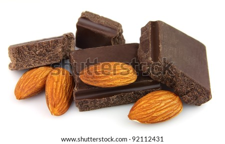 Slices of chocolate and almonds nuts on a white background