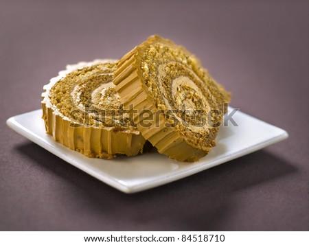 Slices of Christmas coffee log cake