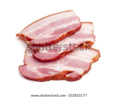 Slices of cured bacon - cut out on white