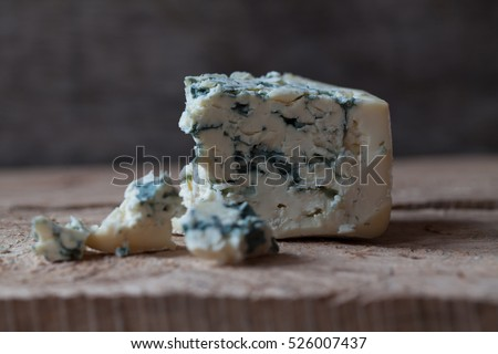 Slices of Danish Blue cheese on an old wooden table, selective focus ストックフォト ©