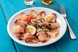 Slices of delicious swordfish carpaccio, Italian cuisine
