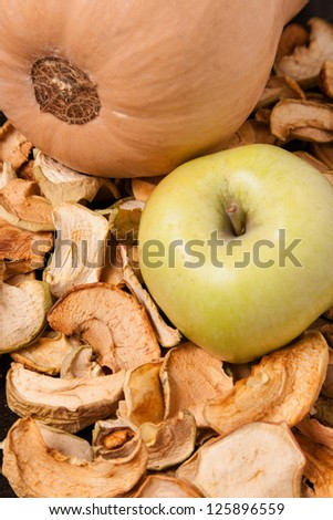 slices of dried apples with fresh apple and pumpkin