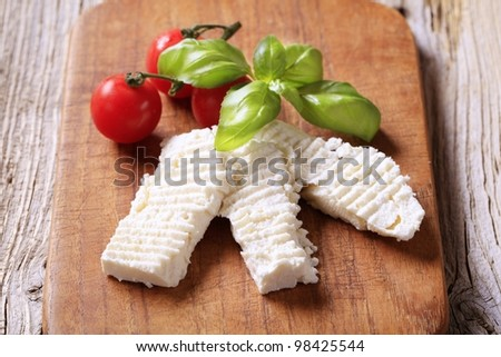 Slices of feta cheese on a cutting board