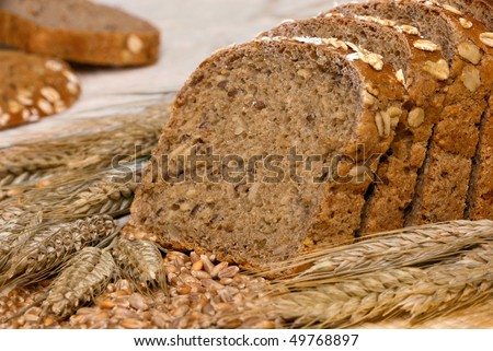 Slices of finest organic bread decorated with natural cereals