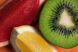 Slices of fresh  kiwi,lemon and grapefruit.Fruit background.Macro food photography.