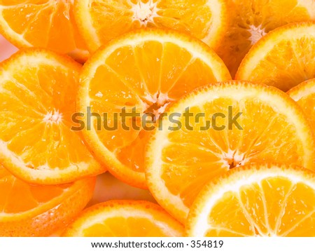 Slices of fresh oranges - stock photo