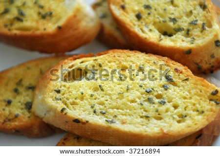 Slices of Garlic Bread on the plate