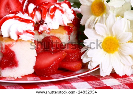 slices of jelly filled angel food cake with strawberries and flowers