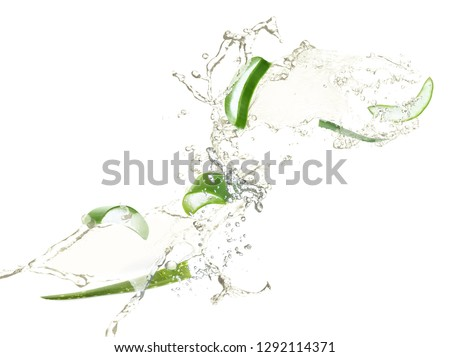Slices of juicy aloe with fresh water splashes on white background