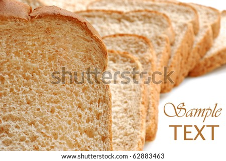 Slices of light wheat bread on white background with copy space.  Macro with shallow dof.
