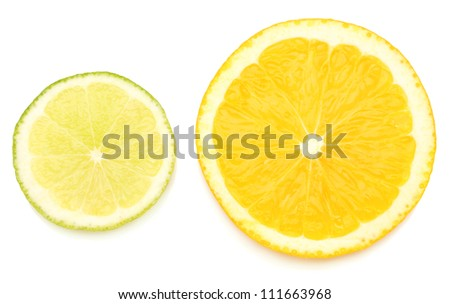 Slices of lime and orange isolated on white