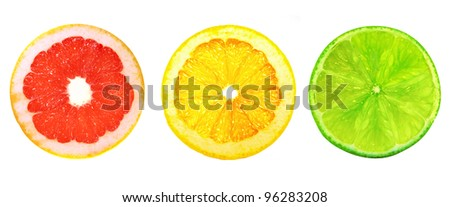 Slices of lime, orange and grapefruit, as a traffic light. On a white background.