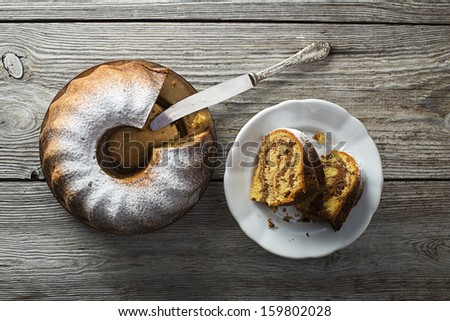 Slices of marble cake sprinkled with sugar