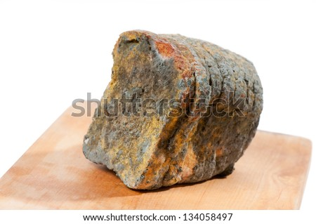Slices of moldy bread on white, old food with toxic mold or mould with plenty colored spores lying on wooden board with white background. Nobody, horizontal orientation.