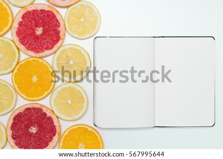 slices of oranges, lemons and grapefruits on vintage white table. Citrus fruit background. healthy eating with natural vitamins. Top view  with copy space - Shutterstock ID 567995644