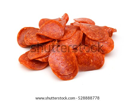 Photo of  slices of pepperoni on white background
