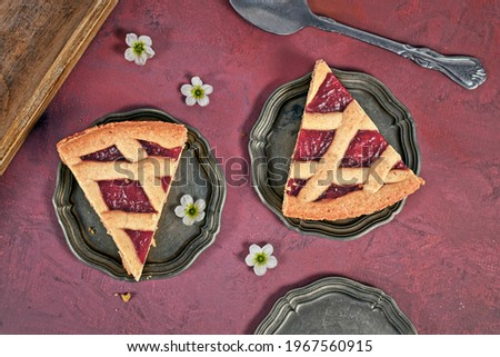 Slices of pie called 'Linzer Torte', a traditional Austrian shortcake pastry topped with fruit preserves and sliced nuts with lattice design Zdjęcia stock ©
