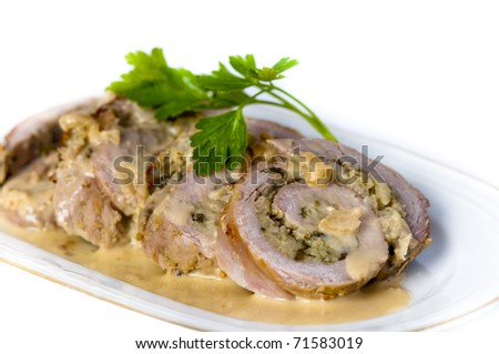 Slices of pork fillet, stuffed with green peppercorns, parsley and sage with a wine and creme fraiche sauce garnished with fresh parsley.