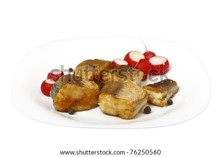 slices of roast hake with radish on a plate isolated on white background