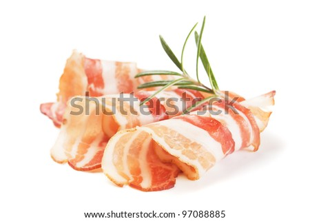 Slices of rolled bacon with rosemary, isolated on white background
