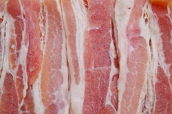 Slices of smoked bacon, close up image