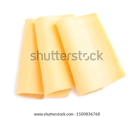 Slices of tasty cheese on white background, top view