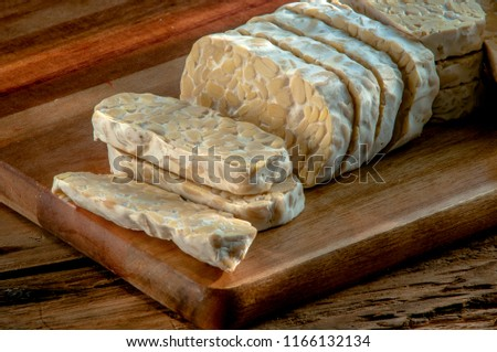 slices of tempe on the wooden table Photo stock ©