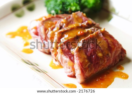 Slices of tender beef with peanut sauce and broccoli