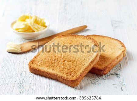Slices of toast bread and butter on wooden table ストックフォト ©