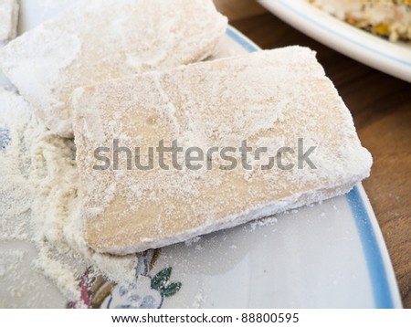 Slices of tofu coated with flour